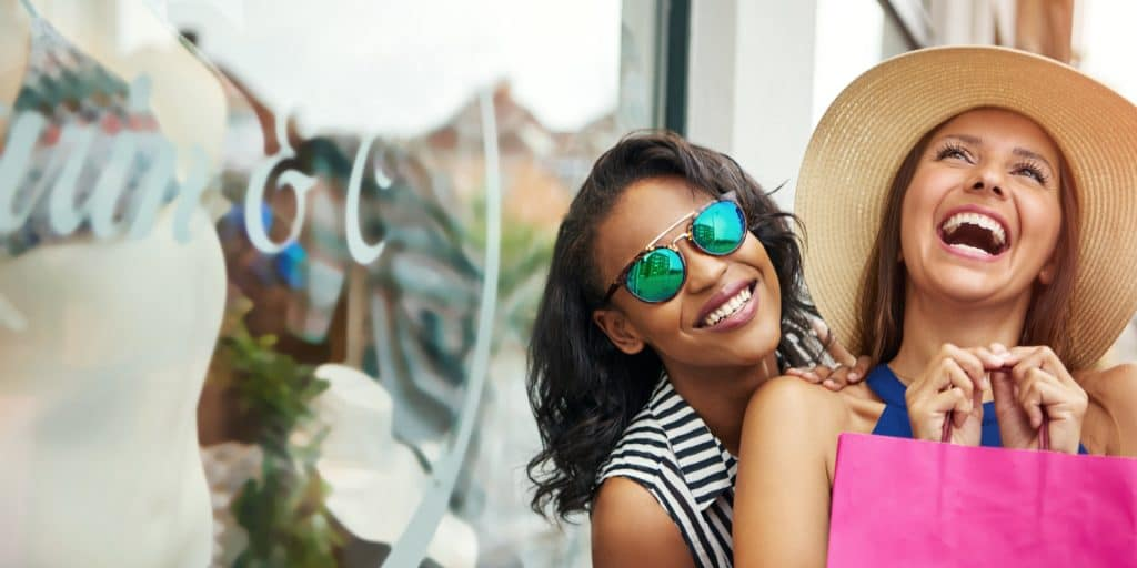 Two happy girls shopping